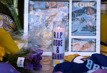 Flowers, photos and messages are placed at a makeshift memorial for former NBA player Kobe Bryant outside of the Mamba Sports Academy in Thousand Oaks