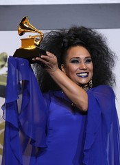 """62nd Grammy Awards – Photo Room – Los Angeles, California, U.S., January 26, 2020 - Aymee Nuviola poses backstage with her Best Tropical Latin Album for """"A Journey Through Cuban Music\"""