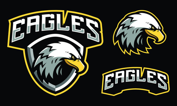 Eagles mascot logo design with extra shield for sport / e-sport logo isolated on black background