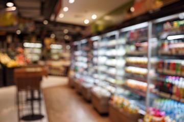 Fototapeta Defocused Image Of Food And Drink On Shelves In Illuminated Store obraz