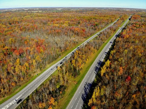 The aerial view of stunning fall foliage near the highway by Watertown, New York, U.S.A