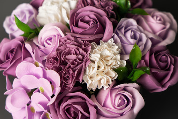 Flowers in bloom: A large bouquet of purple and white roses.