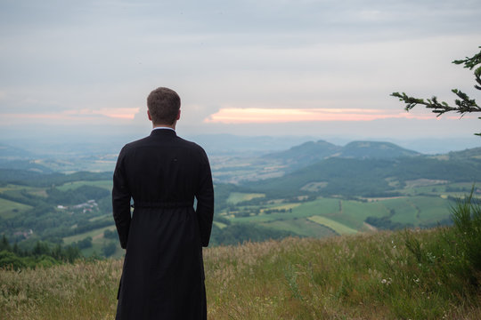 REAR VIEW OF PRIEST OUTDOORS