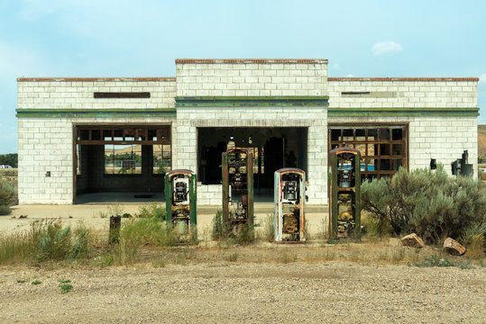 Broken gas pumps at an abandoned service station