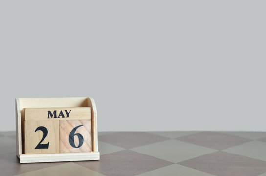 May 26, Empty Background with number cube on the table.