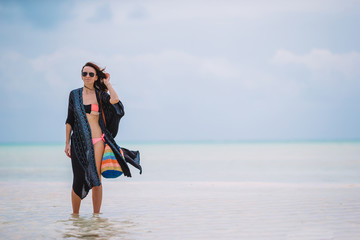 Young beautiful woman on the beach vacation