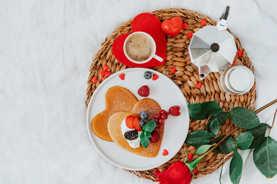 Valentine's Day heart shapes pancake with berries.. morning breakfast with coffee and pancakes