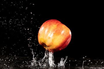 red apple with splashing water drops