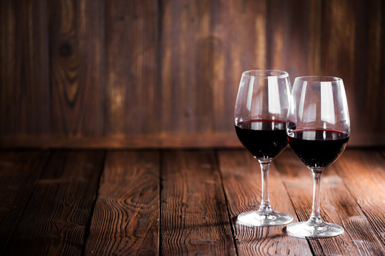 Red wine glasses on wood