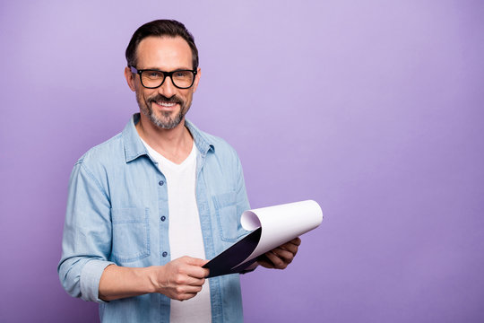 Turned photo of confident cool man hold clip board have meeting with applicant read his resume wear modern outfit isolated over purple color background