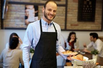 Portrait of happy waiter