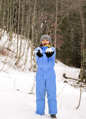 thrilled child screaming for fun with snow clothes playing outdoor