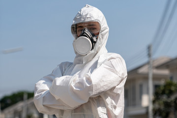 Woman wearing gloves with biohazard chemical protective suit and mask. She crossed her arms with unhappy face. Fotobehang