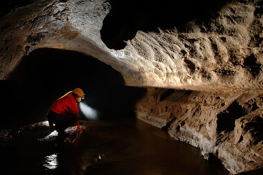 Side View Of Spelunker In Cave