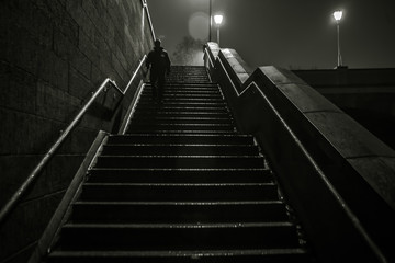 Fotomurales - Low Angle View Of Man Moving Down On Steps At Night