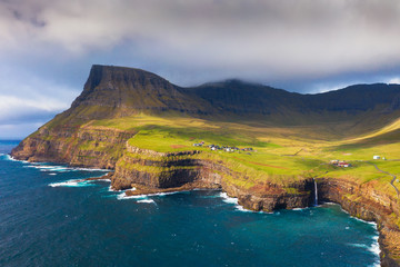 Wall Mural - Aerial view of Gasadalur village and its waterfall in Faroe Islands, Denmark