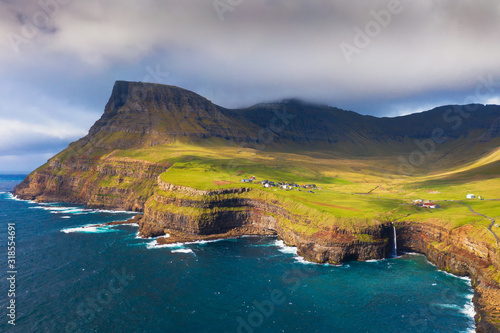 Wall mural Aerial view of Gasadalur village and its waterfall in Faroe Islands, Denmark