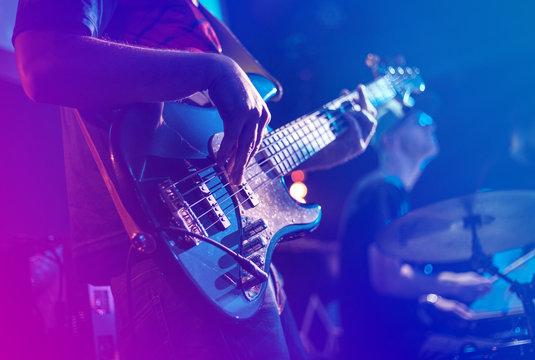 Close up of electric guitar during rock concert