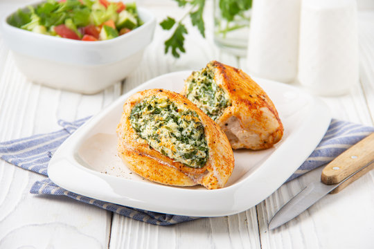 Chicken fillet stuffed with cottage cheese (ricotta, feta) and herbs (parsley, spinach, dill). Delicious homemade food, healthy