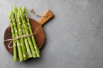 Bunch of green asparagus on concrete background
