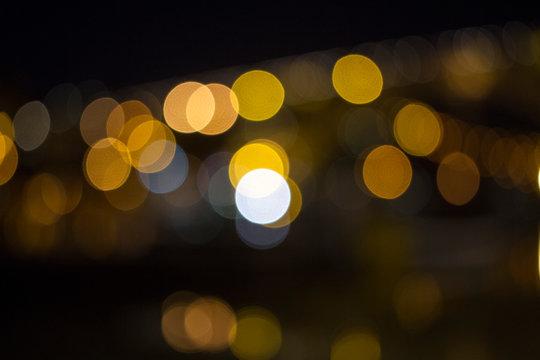 Defocused Image Of Illuminated Yellow Lights At Night