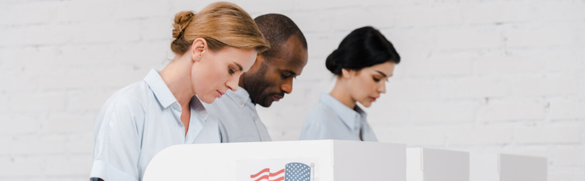 panoramic shot of women and african american man voting near brick wall