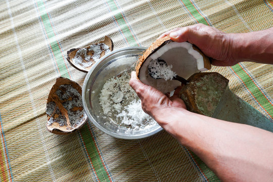 Cropped Hands Of Man Shredding Coconut
