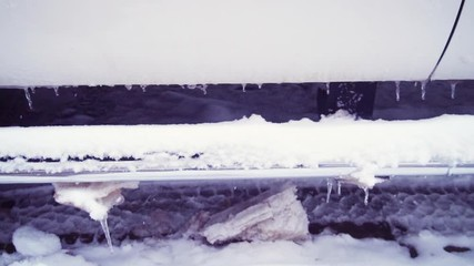 Wall Mural - Slow motion. Passenger car in deep snow on small street.