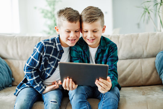 child brother friend having fun tablet laptop  happy kid