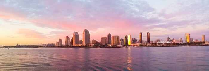CITY AT WATERFRONT DURING SUNSET