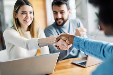 young couple shaking hands deal contract real estate investment