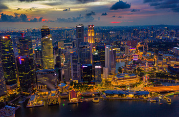 Fototapete - Aerial view of the Singapore landmark financial business district at sunset scene with skyscraper and beautiful sky. Singapore downtown