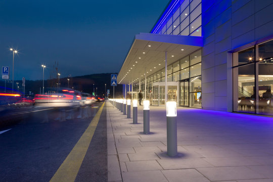 a row of column lighting in front the modern building at night