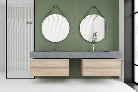 White and green bathroom with sink and shower