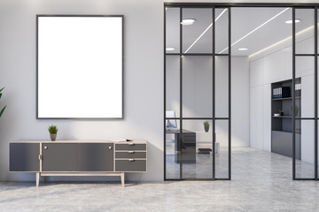 White living room interior with cabinet and poster