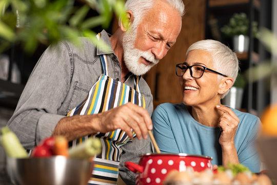 Romantic kitchen moments of senior couple