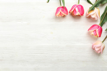 Bunch of spring flowers on textured table backgound with a lot of copy space for text. Top view, close up, flat lay composition.