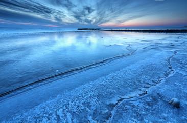 big lake Ijsselmeer frozen in dusk