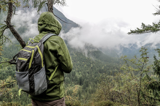 Rear View Of Male Hiker Standing Against Mountains