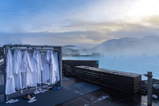 bathrobes in Blue Lagoon next to Reykjavik with people bathing in this natural hot spring .