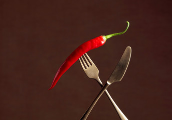Canvas Prints Hot chili peppers Hot chili red pepper on a fork. Spice concept.