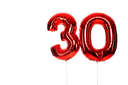 number 30 red balloons isolated on white