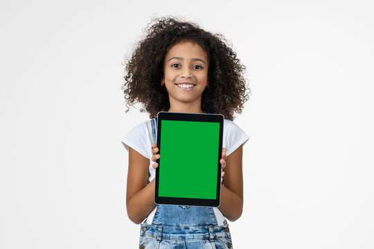 Little girl with the digital tablet on white background