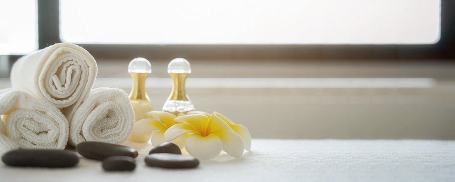 Spa treatment concept. Spa background with spa accessories on white bathroom background.