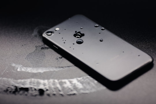 San Francisco, California, USA - 27 January, 2020: back view of iPhone 7 black color with water drops. The iPhone 7 smart phone produced by Apple Computer, Inc.