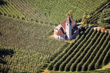 The church St. Valentine midst of apple tree plantations in Merano in South Tyrol, Italy