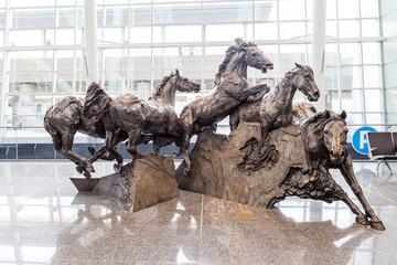 """Breakaway"" bronze statue by Robert Keith Spaith at Calgary International Airport on August 30, 2017"