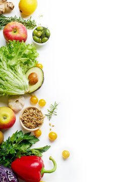 Various healthy raw organic vegetables, herbs, sprouts and fruits isolated on white background. Top view vegetarian food with copy space