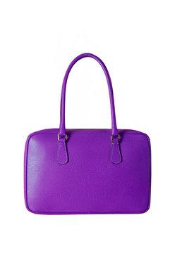 Beautiful purple handbag isolated on white background. High quality leather purse.
