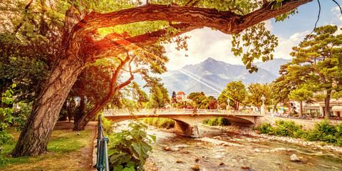 View at sundown to the river Passer and the bridge Via Roma in Merano in South Tyrol, Italy Wall mural